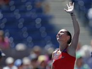 Flavia Pennetta of Italy reacts after defeating compatriot Roberta Vinci at the U.S. Open tennis championships in New York September 4, 2013. REUTERS/Eduardo Munoz