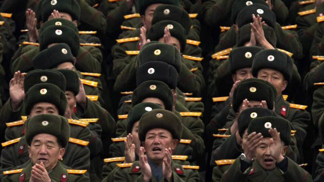 North Korean soldiers applaud during a mass rally organized to celebrate the success of a rocket launch that sent a satellite into space on Kim Il Sung Square in Pyongyang, North Korea, Friday, Dec. 14, 2012. As the U.S. led international condemnation of what it calls a covert test of missile technology, top North Korean officials denied the allegations and maintained the country's right to develop its space program. (AP Photo/Ng Han Guan)