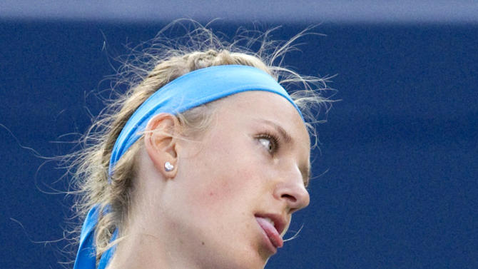 Victoria Azarenka, of Belarus, reacts after losing a point to Serena Williams at the Rogers Cup women's tennis tournament Saturday, Aug. 13, 2011, in Toronto. Williams defeated Azarenka 6-3, 6-3. (AP Photo/The Canadian Press, Darren Calabrese)
