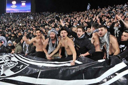 Paok Salonika's supporters cheer their team