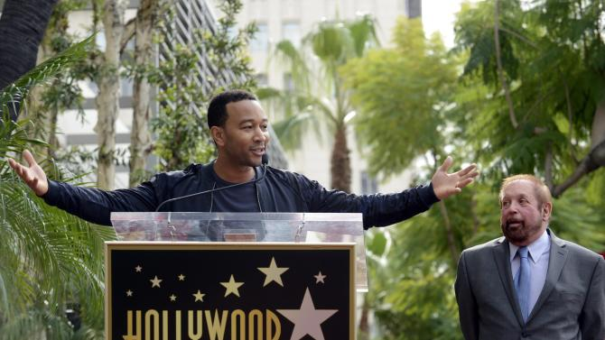 """Recording artist John Legend speaks at a ceremony where television producer Ken Ehrlich receives a star on the """"Hollywood Walk of Fame"""" in Los Angeles"""