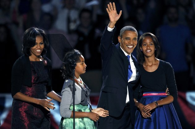 U.S. President Barack Obama, who won a second term in office by defeating Republican presidential nominee Mitt Romney, waves with his daughters Malia (R) and Sasha and wife Michelle (L) before addressing supporters during his election night victory rally in Chicago, November 7, 2012.    REUTERS/Jeff Haynes (UNITED STATES  - Tags: POLITICS ELECTIONS USA PRESIDENTIAL ELECTION TPX IMAGES OF THE DAY)