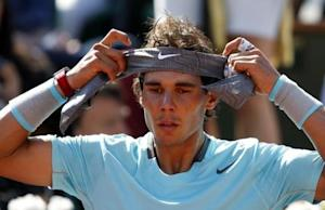 Rafael Nadal of Spain adjusts his head band during his men's semi-final match against Andy Murray of Britain at the French Open tennis tournament at the Roland Garros stadium in Paris