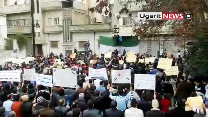 This image made from amateur video and released by Ugarit News purports to show Syrians chanting slogans during a rally in Homs, Syria, Saturday, Jan. 7, 2012. (AP Photo/Ugarit News via APTN) THE ASSOCIATED PRESS CANNOT INDEPENDENTLY VERIFY THE CONTENT, DATE, LOCATION OR AUTHENTICITY OF THIS MATERIAL. TV OUT