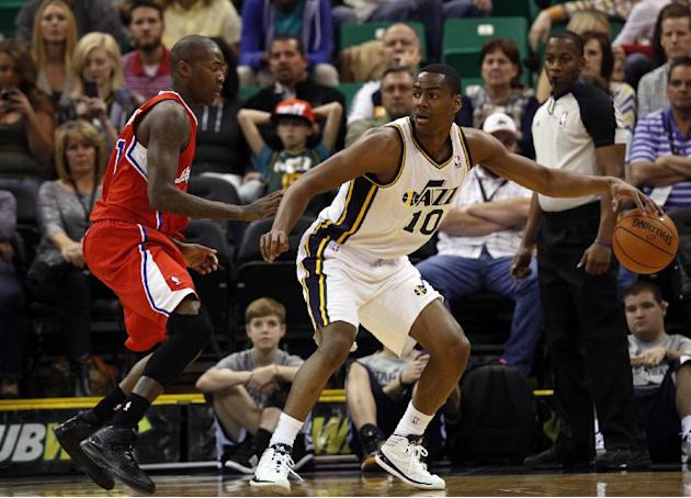 Utah Jazz's Alec Burks, right, looks to pass as Los Angeles Clippers' Jamal Crawford, left, in the first half during an NBA preseason basketball game Saturday, Oct. 12, 2013, in Salt Lake City