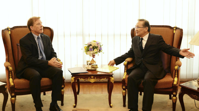 In this photo released by Thai Foreign Ministry, American charge d'affairs in Bangkok, W. Patrick Murphy, left, talks with Thai Deputy Foreign Minister Don Pramudwi during a meeting at the Foreign Ministry in Bangkok, Thailand, Wednesday, Jan. 28, 2015. Thailand's military government summoned the U.S. charge d'affaires to clarify comments by Daniel Russel, U.S. assistant secretary of state for East Asian and Pacific affairs, who called for an end to martial law and said the impeachment of a former prime minister could be politically motivated. (AP Photo/Thai Foreign Ministry)