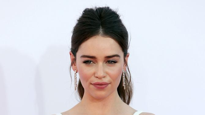 "FILE - This Sept. 23, 2012 file photo shows Emilia Clarke from ""Game of Thrones"" arriving at the 64th Primetime Emmy Awards at the Nokia Theatre in Los Angeles. Producers said Wednesday that a new adaptation of ""Breakfast at Tiffany's"" is aiming for a Shubert theater in New York City in February 2013. The stage adaption of Truman Capote's classic novella will star Emilia Clarke of HBO's ""Game of Thrones"" as Golightly, a role Audrey Hepburn played in the 1961 movie. (Photo by Matt Sayles/Invision/AP, file)"