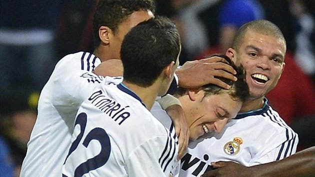 Real Madrid players celebrate with Mesut Ozil (Reuters)