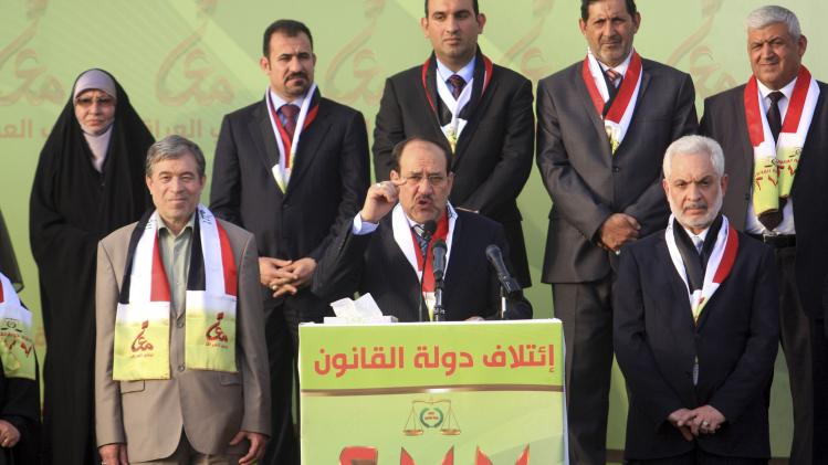 Maliki speaks to his supporters during a ceremony in Kerbala