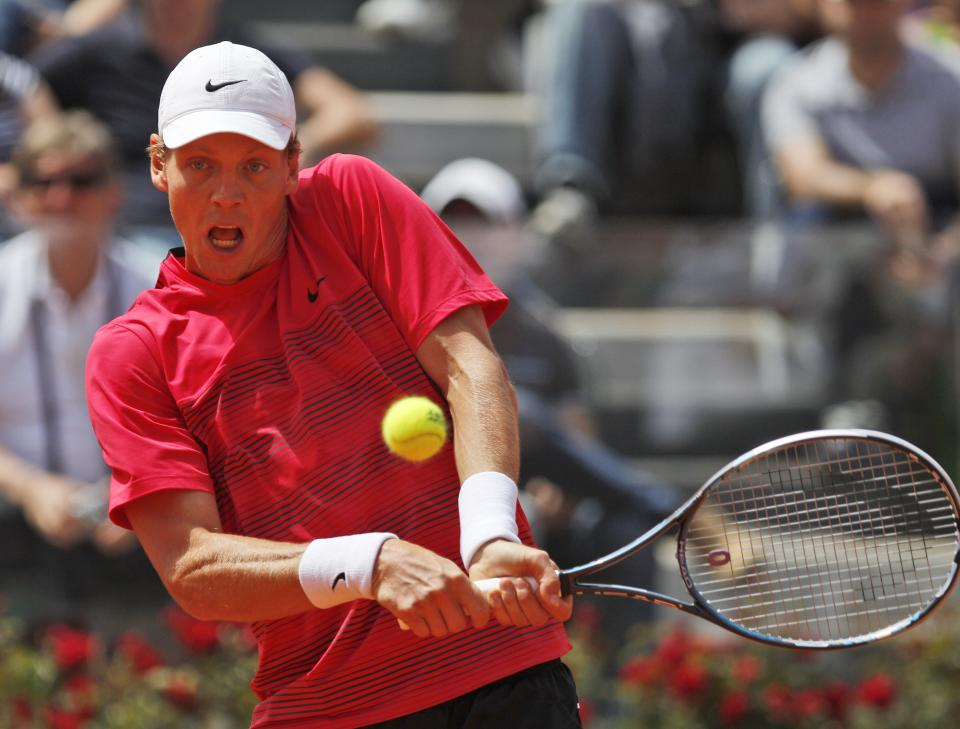 Tomas Berdych, of the Czech Republic, returns the ball to Spain's Rafael Nadal during their quarterfinal match at the Italian Open tennis tournament, in Rome, Friday, May 18, 2012. (AP Photo/Alessandra Tarantino)