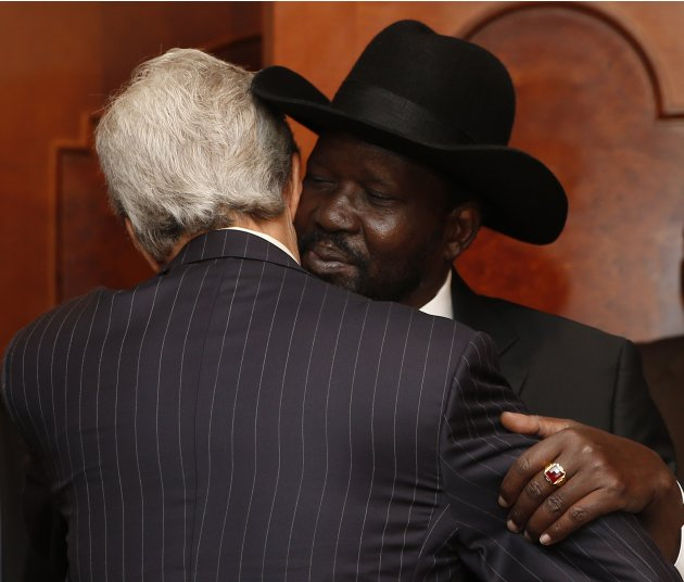 U.S. Secretary of State Kerry hugs South Sudan's President Kiir in Addis Ababa