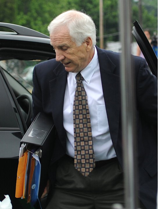 Former Penn State University assistant football coach Jerry Sandusky arrives for the second day his trial at the Centre County Courthouse in Bellefonte, Pa., Tuesday, June 12, 2012.  Sandusky faces 52