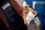 A customs officer shows counterfeited Viagra pills at Paris Roissy airport, in 2009. Thailand has approved an affordable generic version of the anti-impotence drug, as the country looks to combat rampant counterfeit production