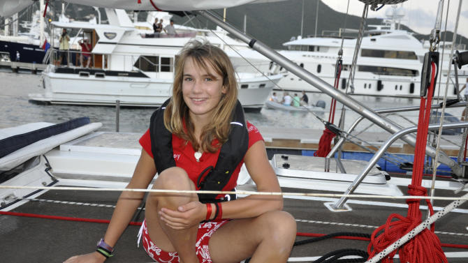 FILE - In this Dec. 19 2010 file photo, Laura Dekker poses on her sailboat Guppy after arriving at Simpson Bay Lagoon near Philipsburg on the Caribbean island of St. Maarten. Now 16 years-old, Dekker is on the final leg of her solo sailing trip, a stint from Cape Town, South Africa, to the Caribbean island of St. Maarten, where she set sail in 2010. She's on pace to reach port around Jan. 24, her lawyer Peter de Lange said on Wednesday, Jan. 11, 2010. (AP Photo/Judy Fitzpatrick, File)