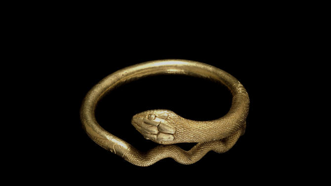 Undated handout photo issued by the British Musuem Thursday Sept. 20, 2012 of a gold bracelet in the form of a coiled snake, 1st Century AD, Roman, Italy as dozens of objects recovered from the ruins of Roman cities Pompeii and Herculaneum will go on show outside Italy for the first time at a new exhibition at the museum.  The two cities on the Bay of Naples were wiped out by the eruption of Mount Vesuvius in 79 AD. The show will feature objects found in their ruins including jewellery, carbonised food and a baby's crib that still rocks on its curved runners. The exhibition will run March 28 to Sept. 29, 2013. (AP Photo/The Trustees of the British Museum)