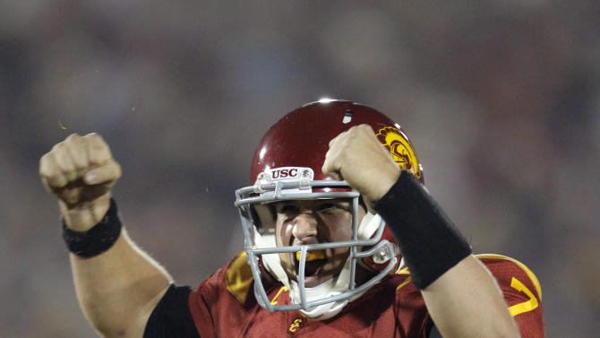 FILE - In this Nov. 26, 2011 file photo, Southern California quarterback Matt Barkley celebrates a touchdown by teammate Rhett Ellison during the first half of an NCAA college football game against UCLA in Los Angeles. USC is ranked No. 1 in the Associated Press preseason college football poll released on Saturday, Aug. 18, 2012. (AP Photo/Jae Hong, File)