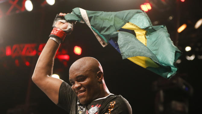 Anderson Silva, from Brazil, celebrates after defeating Stephan Bonnar, from the United States, during their light heavyweight mixed martial arts bout at UFC153 in Rio de Janeiro, early Sunday, Oct. 14, 2012. (AP Photo/Felipe Dana)