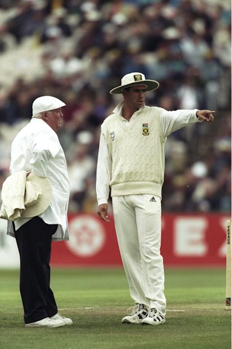 Hansie Cronje of South Africa and Umpire David Shepherd