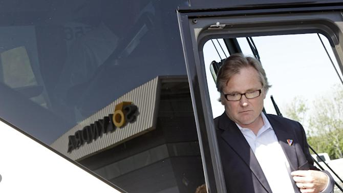The Solyndra logo is reflected on the campaign bus as Republican presidential candidate, former Massachusetts Gov. Mitt Romney follows campaign senior advisor Eric Fehrnstrom, off as they arrive for a news conference outside the Solyndra manufacturing facility,  Thursday, May 31, 2012 in Fremont, Calif.  (AP Photo/Mary Altaffer)