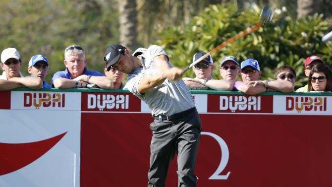 Kaymer of Germany tees off on the first hole during the Dubai Desert Classic