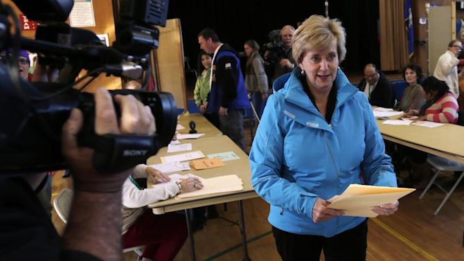 Republican candidate for U.S. Senate Linda McMahon walks with her ballot in hand while voting in Greenwich, Conn., Tuesday, Nov. 6, 2012. McMahon and Democratic opponent Chris Murphy are vying for the Senate seat now held by Joe Lieberman, an independent who's retiring. (AP Photo/Charles Krupa)