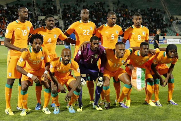 In this Nov. 16, 2013 file photo, Ivory Coast soccer team poses prior to the World Cup 2014 qualifying soccer match between Ivory Coast and Senegal at Mohammed V stadium in Casablanca, Morocco. Backgr