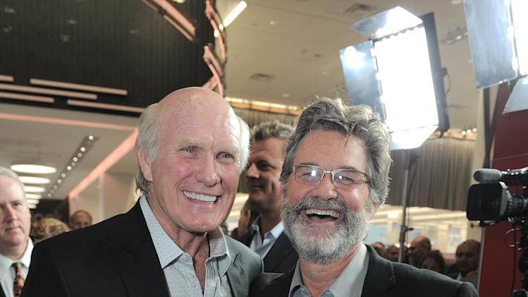 Terry Bradshaw and Kurt Russell attend Walgreens 8000th Store Opening, on Friday Nov. 30, 2012, in Los Angeles. (Photo by Jordan Strauss/Invision for Walgreens/AP Images)