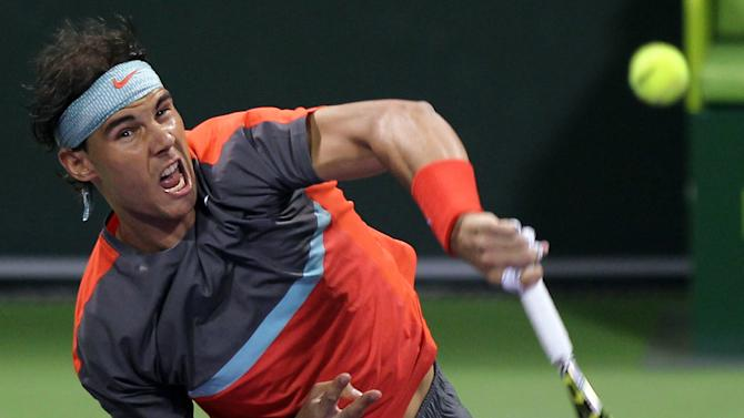 Rafael Nadal of Spain returns the ball to Lukas Rosol of Czech Republic during the Qatar ATP Open Tennis tournament in Doha, Qatar, Tuesday, Dec. 31, 2013. (AP Photo/Osama Faisal)