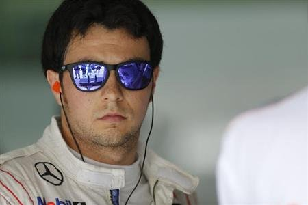 McLaren Formula One driver Sergio Perez of Mexico looks on in the garage during the third practice session of the Malaysian F1 Grand Prix at Sepang International Circuit outside Kuala Lumpur, March 23
