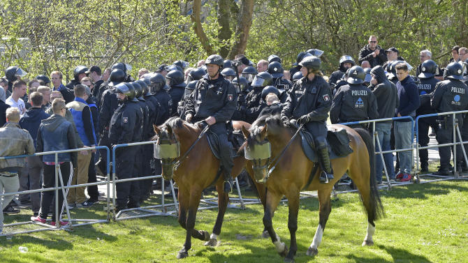 Police patrols around the stadium prior the German Bundesliga soccer match between Werder Bremen and Hamburger SV in Bremen, Germany, Sunday, April 19, 2015. The province Bremen wants the football clubs to pay for the police during critical match days. (AP Photo/Martin Meissner)