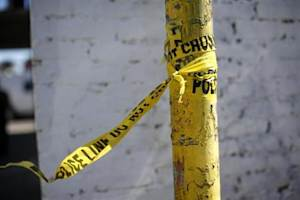 A police line tape is seen at the site of the fatal stabbing of a Los Angeles Dodgers fan after he attended a baseball game in San Francisco