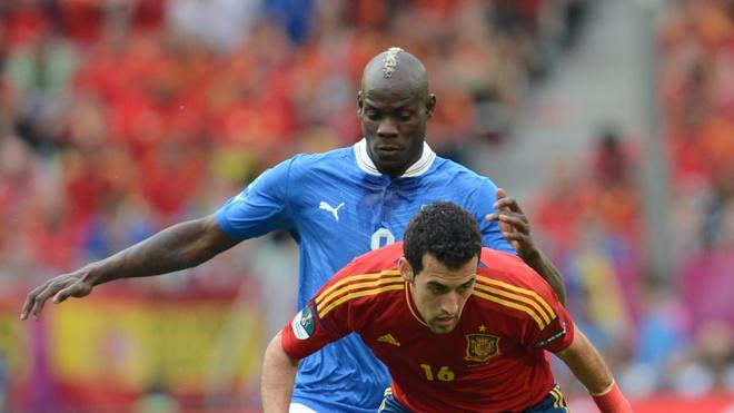 Italian Forward Mario Balotelli (L) Vies AFP/Getty Images