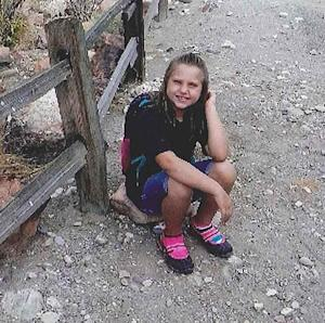 """This undated photo provided by the Bullhead City Police Department shows Isabella """"Bella"""" Grogan-Cannella, an 8-year-old Bullhead City, Arizona, girl who was reported missing on Tuesday, Sept. 2, 2014. Police, firefighters and volunteers fanned out in Bullhead city neighborhoods, nearby parks and river areas to look for the missing child. (AP Photo/Courtesy of the Bullhead City Police Department)"""