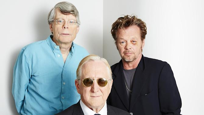 "This June 3, 2013 photo shows, from left, Stephen King, T Bone Burnett and John Mellencamp posing for a portrait in New York. The trio are collaborating on a musical, ""Ghost Brothers of Darkland County."" A traveling production will begin later this year. (Photo by Dan Hallman/Invision/AP)"