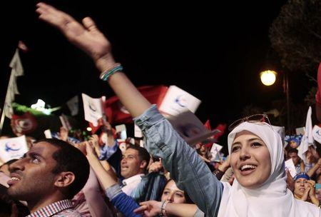 A supporter of the Islamist Ennahda movement shout slogans during a campaign event in Tunis