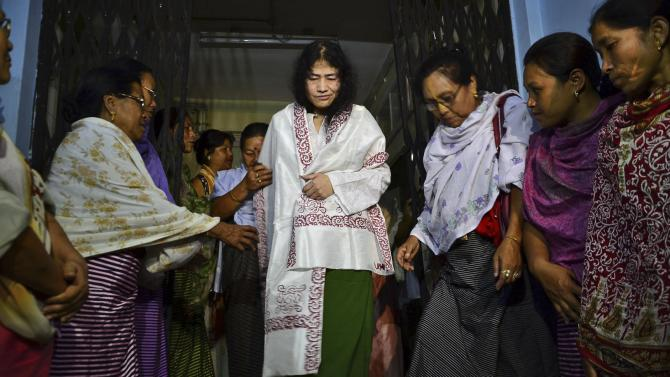 In this Wednesday, Aug. 20, 2014 photo, Irom Sharmila, center, walks out of a security ward after her release in Porompal district, in Imphal, India. India's most famous prisoner of conscience has walked free after nearly 14 years in prison, but vowed to continue the hunger strike that landed her in prison for attempted suicide. (AP Photo/Bullu Raj)