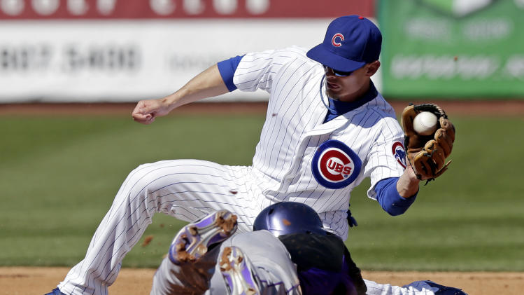 Colorado Rockies' Carlos Gonzalez, bottom, steals second with Chicago Cubs' Brent Lillibridge covering during the fourth inning of an exhibition spring training baseball game, Tuesday, Feb. 26, 2013, in Phoenix. (AP Photo/Morry Gash)