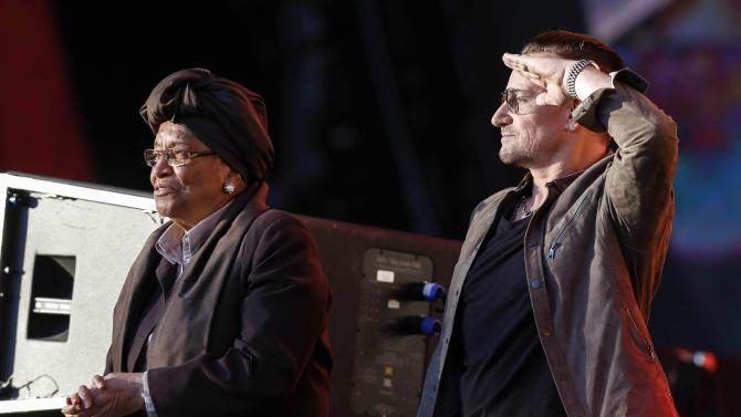 Singer Bono salutes Liberian President Ellen Johnson Sirleaf during the Global Citizen Festival in New York
