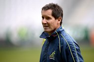 Australia coach Robbie Deans takes part in a training session on November 9, 2012, at the Stade de France. The embattled Deans is keen to stay in the job until the 2015 World Cup, but Australia&#39;s new rugby chief says he will have to reapply for the role when his contract runs out