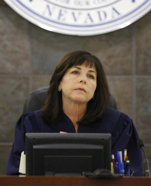 """FILE - This Dec. 5, 2008 file photo shows District Court Judge Jackie Glass listening during O.J. Simpson's sentencing hearing at the Clark County Regional Justice Center in Las Vegas. In a statement released Tuesday, May, 24, 2011, Glass, who sentenced O.J. Simpson to prison, said she plans to take over for Nancy Grace on the syndicated television show """"Swift Justice."""" (AP Photo/Ethan Miller, Pool, File)"""
