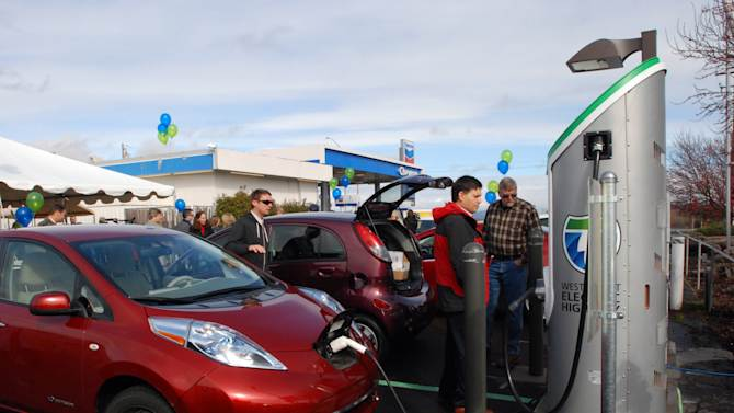 FILE - In this March 16, 2012 file photo, a Nissan Leaf tops off it's battery in Central Point, Ore., at one of the charging stations along Interstate 5. If you didn't take advantage of a wide array of tax credits and deductions last year, it looks like you'll be out of luck in 2014. Tax credits for certain electric cars though continue into 2014. (AP Photo/Jeff Barnard, File)