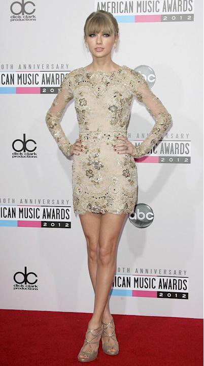 AMAs 2012: Taylor Swift looked incredible in this lace long-sleeved embellished mini dress. We cannot get over those legs. Taylor also walked away with the best Country artist gong, which we reckon is