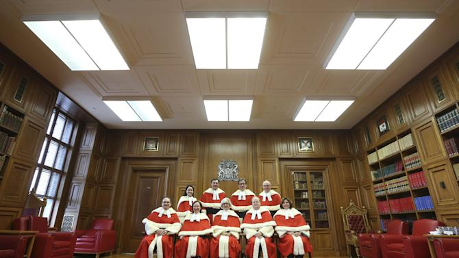 Canada's Supreme Court Justices pose for a photo before a welcoming ceremony in Ottawa