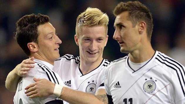 Miroslav Klose, Marco Reus and Mesut Ozil for Germany