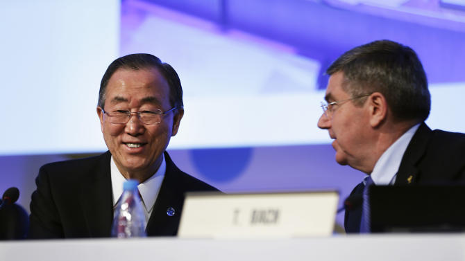 United Nations Secretary-General Ban Ki-moon, left, sits next to International Olympic Committee President Thomas Bach after Ban addressed the IOC general assembly ahead of the upcoming 2014 Winter Olympics, Thursday, Feb. 6, 2014, in Sochi, Russia. It was the first time a U.N. secretary-general delivered a keynote address to the IOC's general assembly. (AP Photo/David Goldman)