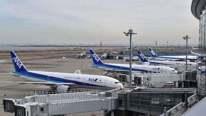 Japan's All Nippon Airways planes wait on the tarmac at Tokyo's Haneda airport, January 29, 2015