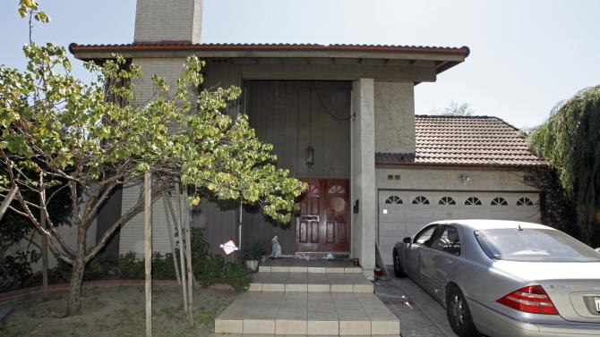 """A car sits parked at the suburban Los Angeles home believed to be that of filmmaker Nakoula Basseley Nakoula, Friday, Sept. 14, 2012. Federal authorities have identified Nakoula, a self-described Coptic Christian, as the key figure behind """"Innocence of Muslims,"""" a film denigrating Islam and the Prophet Muhammad that ignited mob violence against U.S. embassies across the Middle East. (AP Photo/Reed Saxon)"""