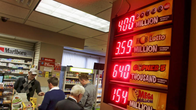 The $400 miliion Powerball jackpot tops the list of lottery payouts in this convenience store in the Minneapolis skyway system, Tuesday, Feb. 18, 2014. Jackpots like Wednesday's anticipated $400 million Powerball can grant a lot of wishes. Should a winner have but one chance to blow all that money on a single purchase and ignore the cautious advice of accountants and money managers, real estate listings, auction houses and even simple web searches are full of ideas to separate someone and their newfound wealth.(AP Photo/Jim Mone)