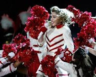 "US pop diva Madonna performs during her ""MDNA"" world tour at Kiev's Olympic Stadium on August 4. The lead singer of the Russian punk band Pussy Riot has compared the group's trial to Stalin-era repression in a dramatic final statement before the verdict is delivered later this month"