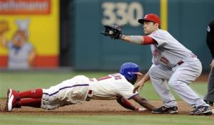 Votto, Arroyo lead Reds over Phillies